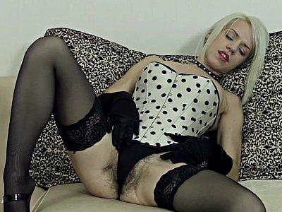 Blonde in a corset peeking her hairy pussy