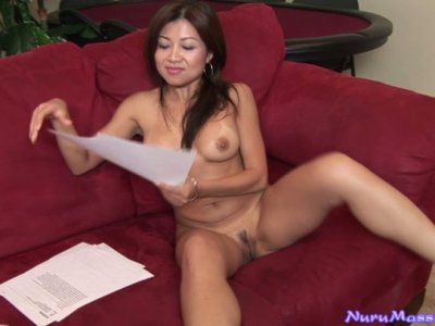 Sexy Oriental chick Jackie Lin gets naked and pretends to be working