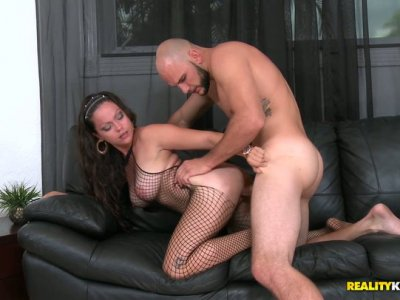 Buxom brunette pleases the stiff cock of the bald dude