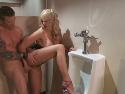 Blonde milf Stormy Daniels fucks and eats cum in the men's rest room