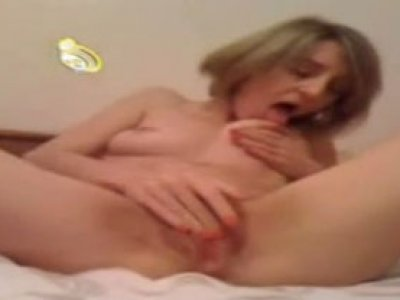 Ugly chick turns on webcam and tickles both her holes with delight