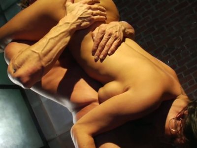 Muscular macho holds Claudia Valentine upside down and eats her pussy