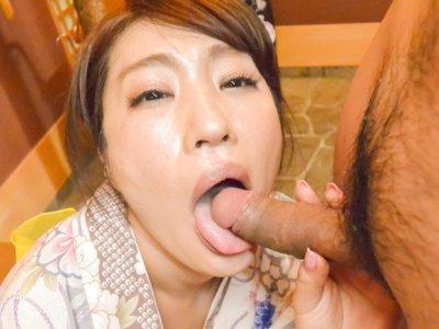 WifeRyouka Shinoda kneels to suck this guy's dick