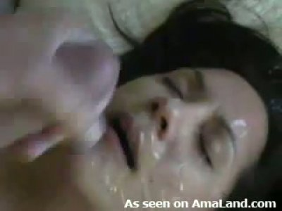 Brunette wife licking ball sand getting messy facial